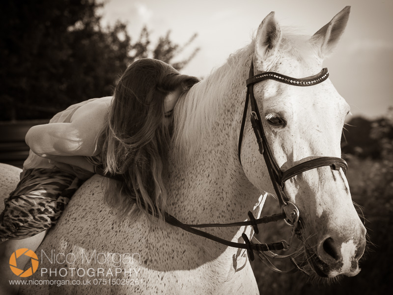 equestrian-photographer-girl-with-rides-grey-horse-dress-bandw