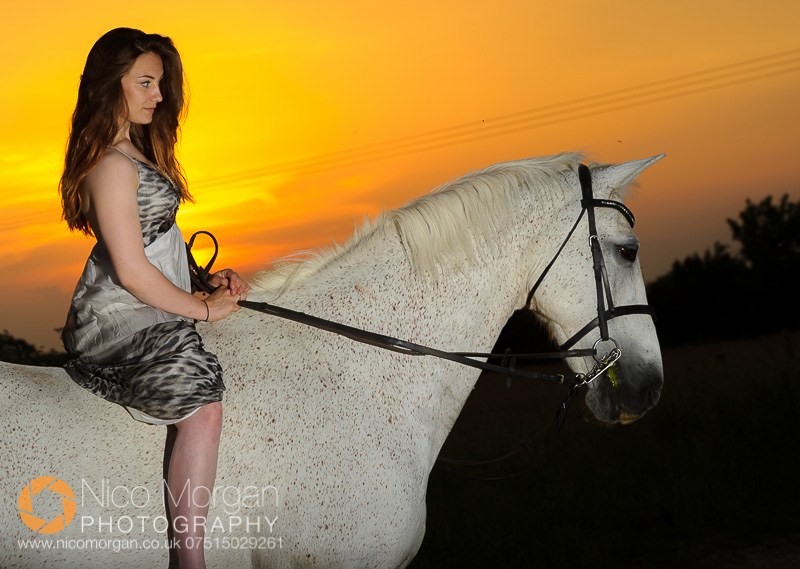 equestrian-photographer-girl-with-rides-grey-horse-dress-flash-sunset