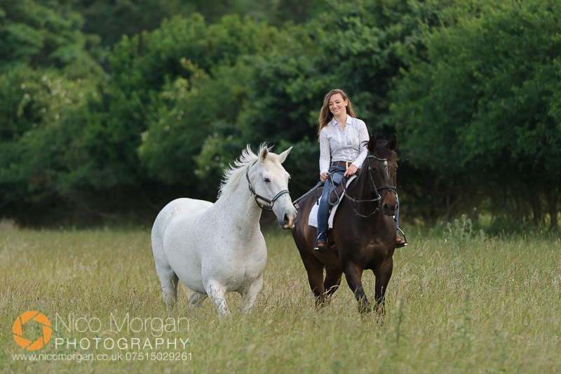 girl on bay horse leads grey horse - Equine photography - Yard Shoot in Bulby, Lincolnshire