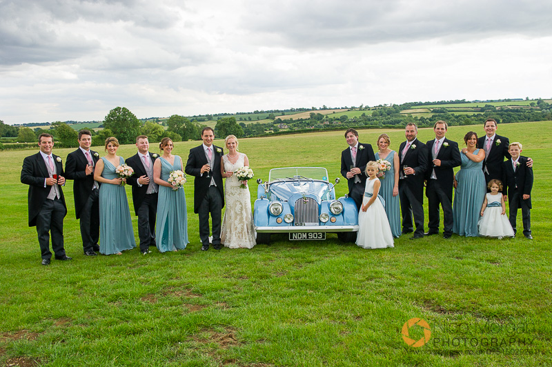Group with the wedding car