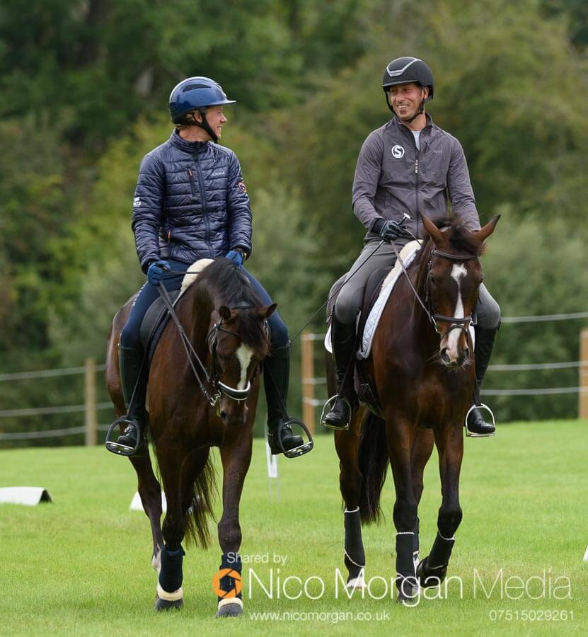 Ludwig Svennerstal and Tim Price share a joke in the warm up arena.