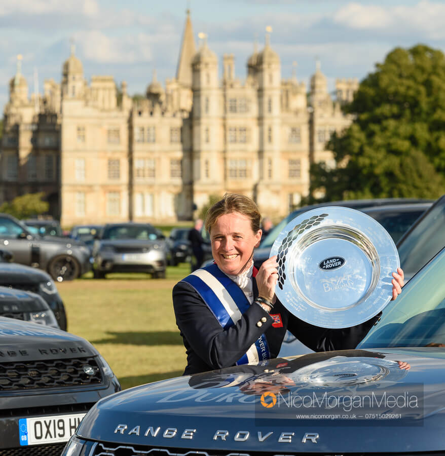 Pippa Funnell with the Land Rover Trophy in front of Burghley House